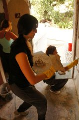 Girls in the action, lime plaster application.
