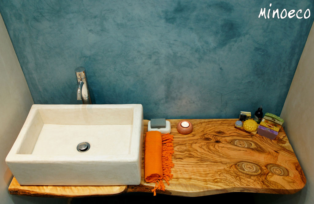 Tadelakt bathroom walls, tadelakt sink on countertop from olive wood. Crete, Greece